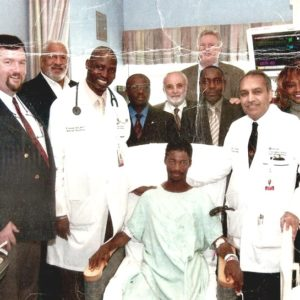 MD with His late boss and hospital officials after the surgery