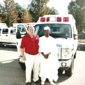 MD With Mr Scott at Ambulance Factory in Atlanta.jpg